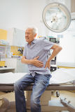 Mature man with lower back pain Stock Photo