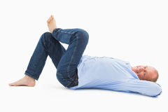 Mature man lying and smiling Stock Images
