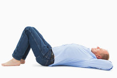 Mature man lying and smiling Royalty Free Stock Image