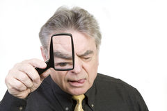 Mature Man with Magnifying Glass Stock Images