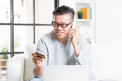 Mature man making order by phone Royalty Free Stock Photo