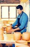 Mature man making pot Stock Image