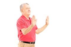 Mature man meditating Royalty Free Stock Photography