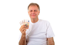 Mature man with money Royalty Free Stock Photo
