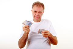 Mature man with money. Portrait of mature man holding money royalty free stock photography