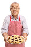 Mature man offering freshly baked pie Stock Photo