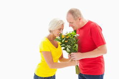 Mature man offering his partner flowers Royalty Free Stock Photo