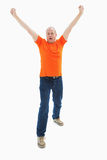 Mature man in orange tshirt cheering Royalty Free Stock Photo