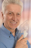Mature man with oxygen mask. Close up stock images