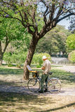 Mature man painting on canvas in a park. 19, 2015: SEVILLA, SPAIN - FEBRUARY 12, 2015: Mature man painting on canvas in a park. May spring in the beautiful city Stock Images