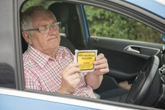 Mature man with parking fine looking annoyed. And fed up royalty free stock photography