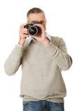 Mature man with photo camera Royalty Free Stock Photos