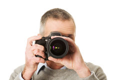 Mature man with photo camera Royalty Free Stock Photos