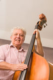 Mature man playing bass Royalty Free Stock Photography