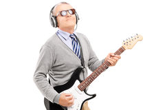 Mature man playing guitar. Isolated on white background Royalty Free Stock Image