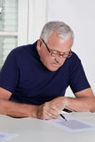 Mature Man playing Scrabble Game Stock Photography