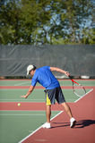 Mature Man Playing Tennis Stock Images