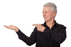 Mature man pointing with his finger Royalty Free Stock Images