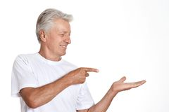 Mature man pointing with his finger Stock Photography
