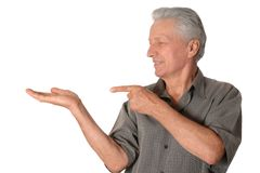 Mature man pointing with his finger Stock Photo