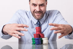 Mature man with poker chips, looking greedy Stock Photos