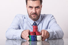 Mature man with poker chips, placing bet Royalty Free Stock Images