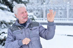 Mature man portrait. Close up, outdors in winter Royalty Free Stock Photography