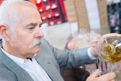 Mature man pouring wine royalty free stock image