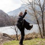 Mature man practicing Tai Chi discipline outdoors stock images