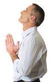 Mature man praying to God Stock Photos