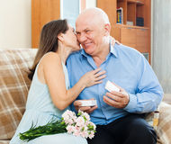 Mature man presenting woman jewel Stock Image