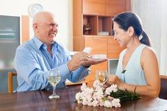 Mature man presenting woman jewel Royalty Free Stock Photo