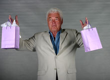 MAture man with presents Royalty Free Stock Images