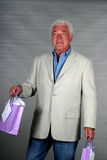 Mature man with presents Royalty Free Stock Photography