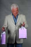 Mature man with presents Royalty Free Stock Photos