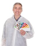 Mature Man With Protective Workwear Holding Color Swatch Stock Image