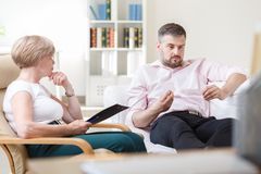 Mature man on psychotherapy session Stock Photo