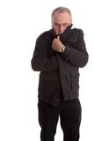 Mature man pulling his jacket up Royalty Free Stock Photography