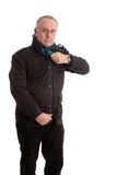 Mature man putting his jacket on Royalty Free Stock Photos