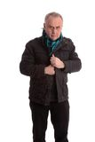 Mature man putting his jacket on Royalty Free Stock Photography