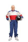 Mature man in racing suit holding helmet Stock Photography