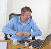 Mature man in rage while working Royalty Free Stock Photo