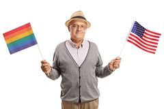 Mature man with a rainbow flag and an American flag. Isolated on white background Stock Photography