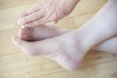 Mature man reaching for toes Stock Images