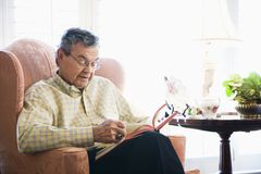 Mature man reading. Stock Photo