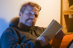 Mature man reading book Stock Photos