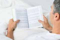 Mature man reading book Stock Image