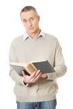 Mature man reading a book Royalty Free Stock Photos