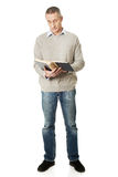 Mature man reading a book. Handsome mature man reading a book royalty free stock photography
