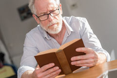 Mature man reading a book Stock Photo